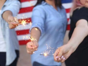 fourth of july keto recipes - three women holding sparklers in front of american flag