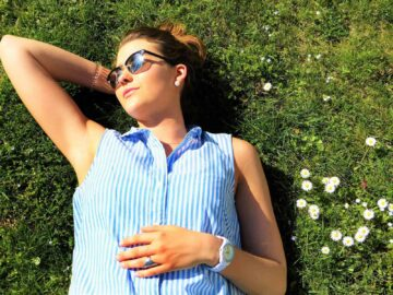 The role of vitamin D in autoimmune disease - woman laying in the sun on grass