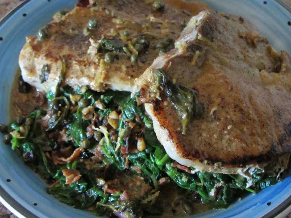 Spinach Stuffed Pork Chop with Lemon Caper Sauce on a Plate