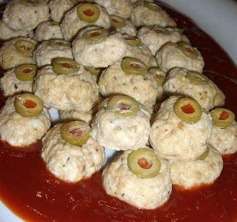 bloody chicken eyeballs meatballs in a dish