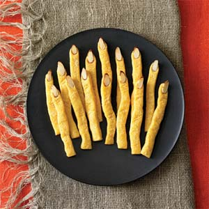 cheddar witches finger crackers on a party table