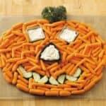 Halloween veggie tray on wooden cutting board