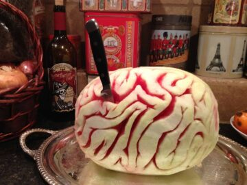 melon brain with a knife in it on a party table