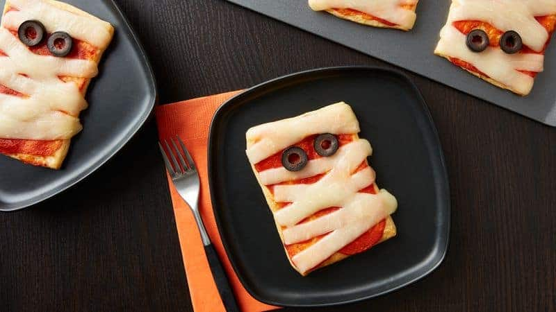 mini mummy pizzas on a plate