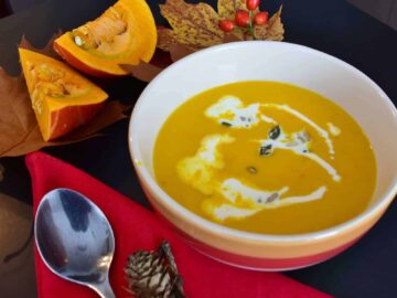 pumpkin sausage soup in a bowl on a fall decorated table