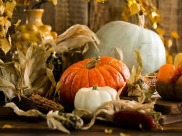 Thanksgiving Party Planning on a Budget: Pumpkin, Corn Cob, and Persimmon Centerpiece