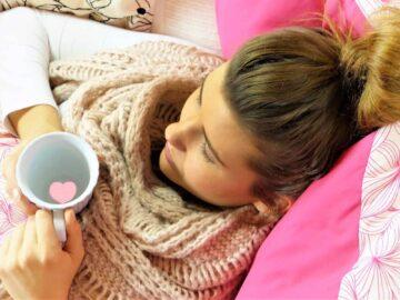 Keto flu tips & tricks - Woman sick in bed