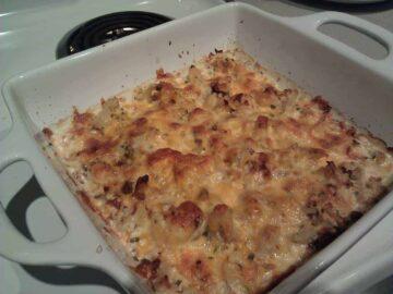Cheesy Bacon Cauliflower in a white baking dish