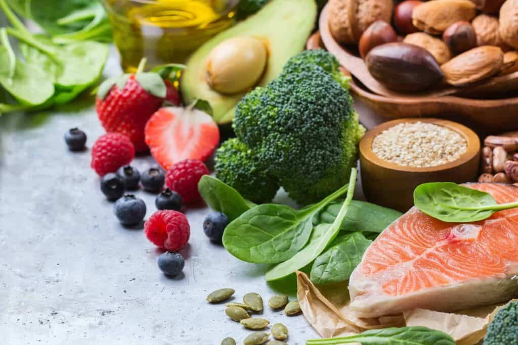 Micronutrients and macronutrients: fruit, vegetables, meats, and grains on a countertop