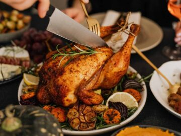 carving the bird on thanksgiving dinner table